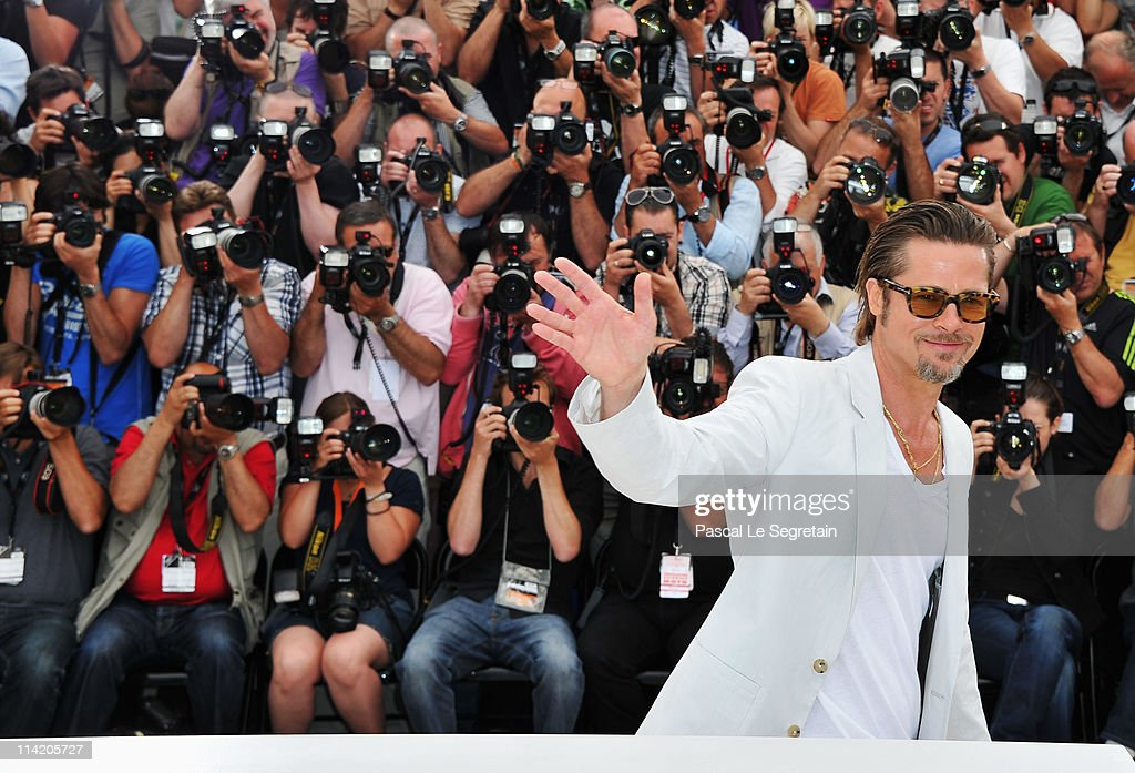 Actor Brad Pitt poses for photos as he attends 'The Tree Of Life' photocall during the 64th Annual Cannes Film Festival at Palais des Festivals on May 16, 2011 in Cannes, France.