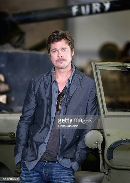 Actor Brad Pitt poses in front of a Sherman Tank during a photocall for the film 'Fury' at Bovington Tank Museum on August 28 2014 in Bovington...