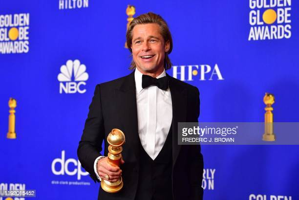 TOPSHOT US actor Brad Pitt poses in the press room with the award for Best Performance by an Actor in a Supporting Role in a Motion Picture during...
