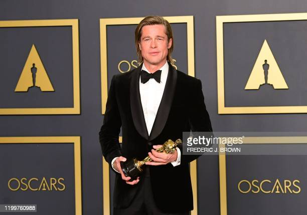 TOPSHOT Actor Brad Pitt poses in the press room with the Oscar for Best Supporting Actor during the 92nd annual Oscars at the Dolby Theater in...