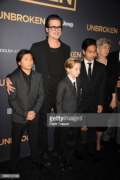 Actor Brad Pitt posing with his children Pax JoliePitt Shiloh JoliePitt and Maddox JoliePitt and his parents Jane Etta Pitt and William Alvin Pitt at...
