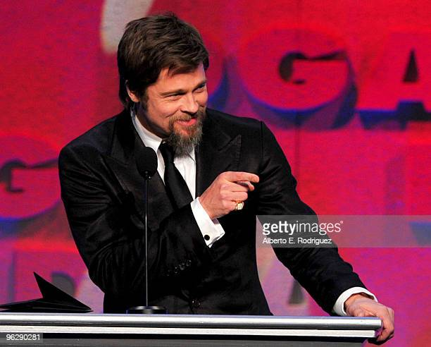 Actor Brad Pitt presents the Feature Film Nomination Plaque to Director Quentin Tarantino for 'Inglourious Basterds' onstage during the 62nd Annual...