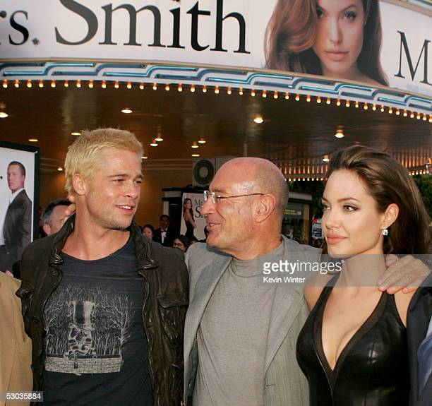 Actor Brad Pitt Producer Arnon Milchan and actress Angelina Jolie arrive at the premiere of 'Mr Mrs Smith' at the Mann Village Theater on June 7 2005...