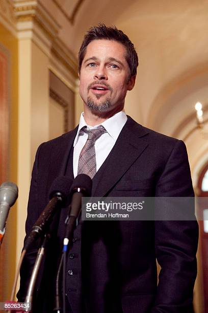 Actor Brad Pitt speaks to the media as he attends with House Speaker Nancy Pelosi and Majority Whip Rep James Clyburn a press conference following a...