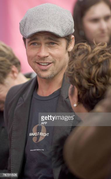 US actor Brad Pitt speaks with local politicians prior to a press conference about his plans to spend USD12 million with his Make It Right Project to...