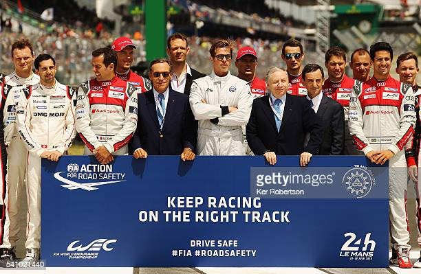 Actor Brad Pitt stands with drivers from the Audi Porsche and Toyota teams Lindsay OwenJones the President of the FIA's Endurance Commission FIA...