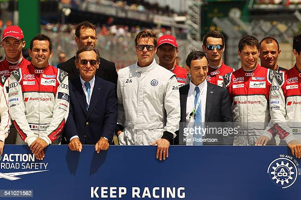 Actor Brad Pitt stands with drivers from the Audi Porsche and Toyota teams Lindsay OwenJones the President of the FIA's Endurance Commission and ACO...