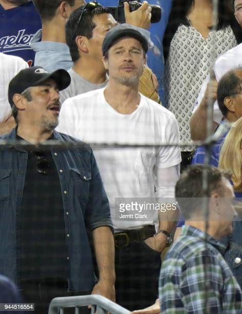 Actor Brad Pitt takes part in the 7th Inning Stretch during The Los Angeles Dodgers Game at Dodger Stadium on April 10 2018 in Los Angeles California