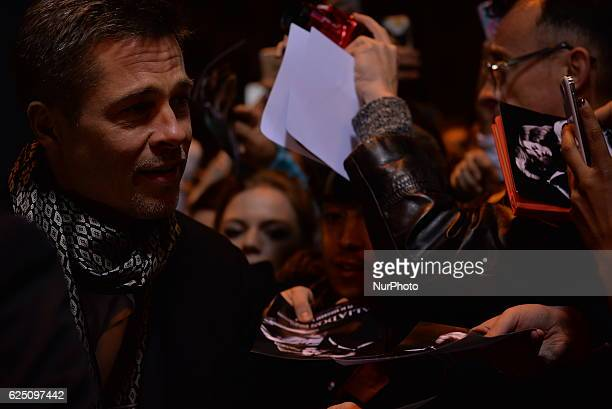 US actor Brad Pitt takes selfie to his fans as they arrive to attend the Spain premiere of the film 'Allied' in Callao City Lights central Madrid on...