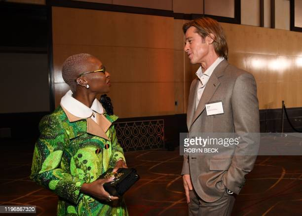 US actor Brad Pitt talks with British actress Cynthia Erivo during the 2020 Oscars Nominees Luncheon at the Dolby theatre in Hollywood on January 27...