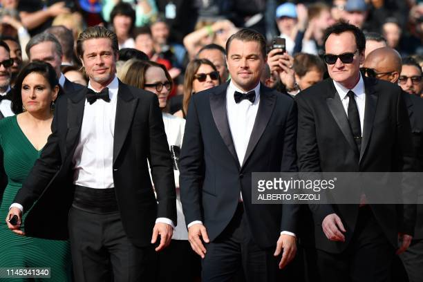 TOPSHOT US actor Brad Pitt US actor Leonardo DiCaprio and US film director Quentin Tarantino arrive for the screening of the film Once Upon a Time in...