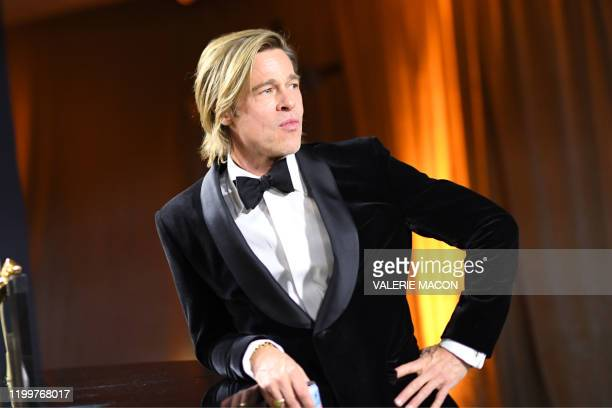 Actor Brad Pitt waits for his award for Best Actor in a Supporting Role to be engraved as he attends the 92nd Oscars Governors Ball at the Hollywood...
