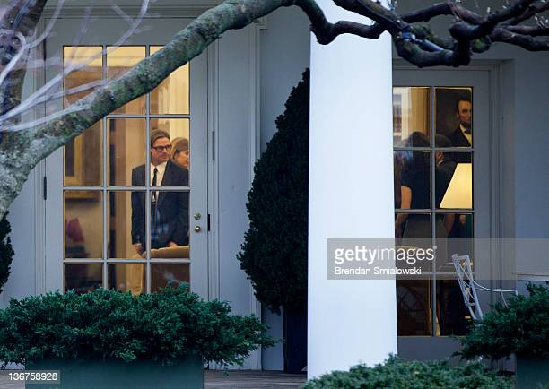 Actor Brad Pitt walks through the Oval Office of the White House after a meeting January 11 2012 in Washington DC Angelina Jolie was in Washington to...