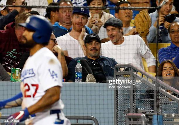 Actor Brad Pitt watches a baseball game between the Los Angeles Dodgers and the Oakland Athletics on April 10 at Dodger Stadium in Los Angeles CA