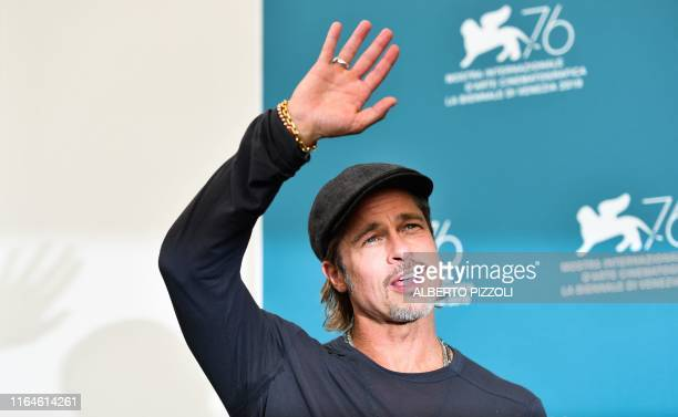 US actor Brad Pitt waves during a photocall on August 29 2019 for the film Ad Astra during the 76th Venice Film Festival at Venice Lido