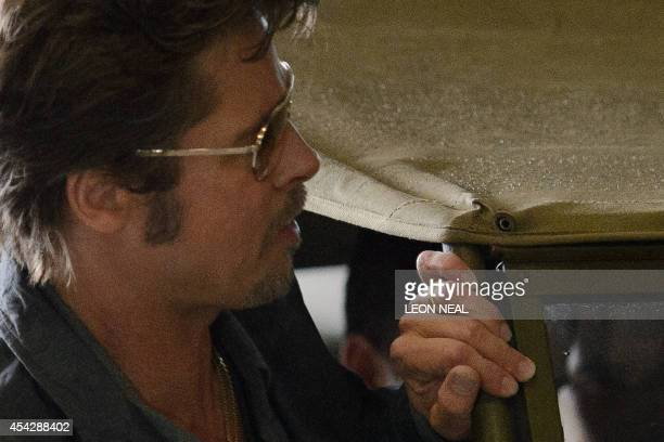 US actor Brad Pitt wearing his wedding ring arrives for a photocall to promote his latest film 'Fury' at Bovington tank museum in Dorset southern...