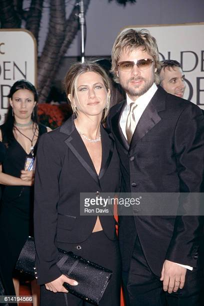 Actor Brad Pitt wearing the Burberry 8933S sunglasses arrives alongside wife actress Jennifer Aniston at the 59th Annual Golden Globe Awards on...