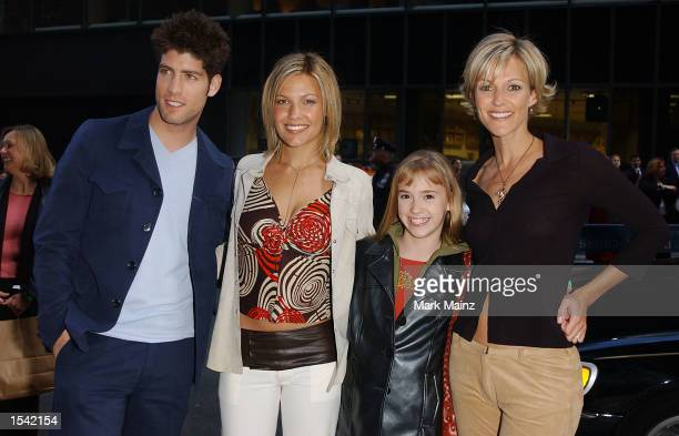 Actor Brad Raider poses for photographs with Kiele Sanchez Andrea Bowen and Bess Armstrong for the ABC Upfront lineup announcment party at Cipriani's...