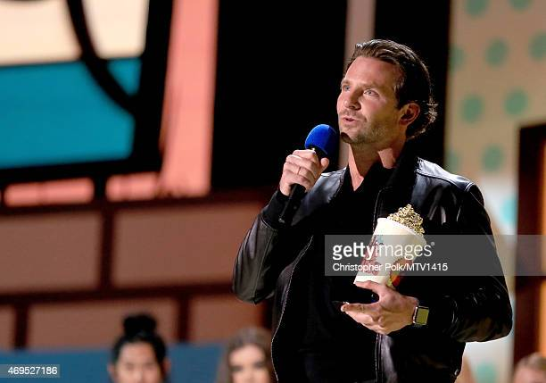 Actor Bradley Cooper accepts Best Male Performance for 'American Sniper' onstage during The 2015 MTV Movie Awards at Nokia Theatre LA Live on April...
