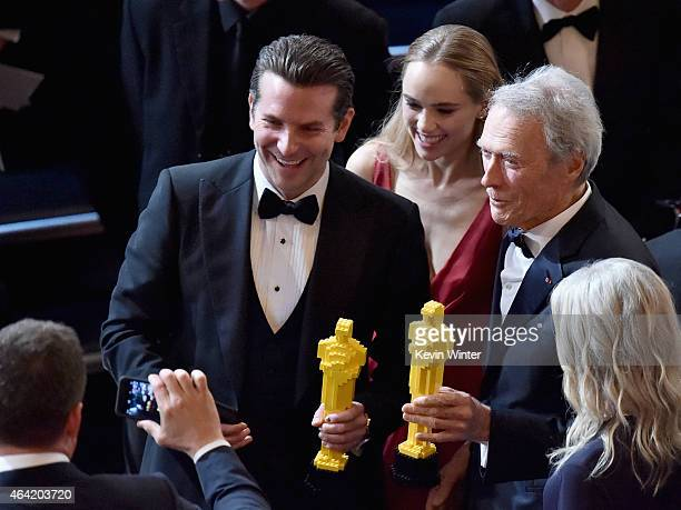 Actor Bradley Cooper and actor/director Clint Eastwood with guests onstage during the 87th Annual Academy Awards at Dolby Theatre on February 22 2015...