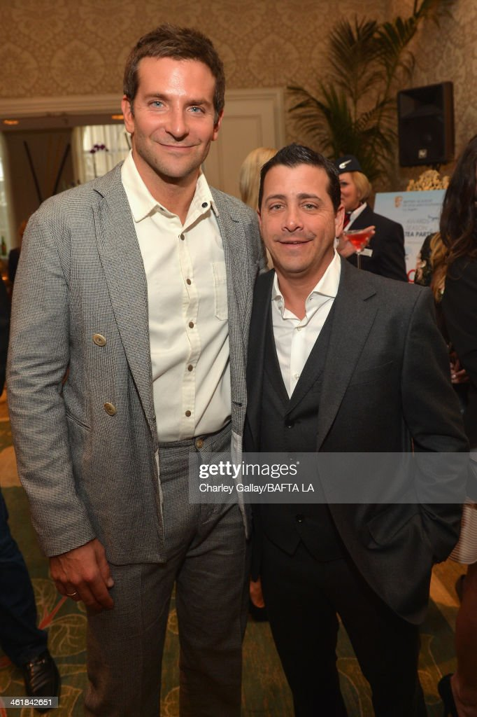 Actor Bradley Cooper (L) and David Glasser, COO of The Weinstein Company attend the BAFTA LA 2014 Awards Season Tea Party at the Four Seasons Hotel Los Angeles at Beverly Hills on January 11, 2014 in Beverly Hills, California.