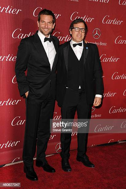 Actor Bradley Cooper and director David O Russell arrive at the 25th annual Palm Springs International Film Festival awards gala at Palm Springs...