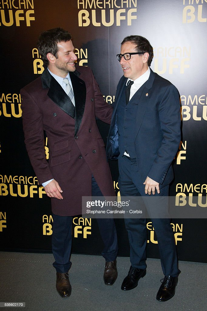Actor Bradley Cooper and director David O. Russell attend the 'American Bluff' Paris Premiere at Cinema UGC Normandie, in Paris.