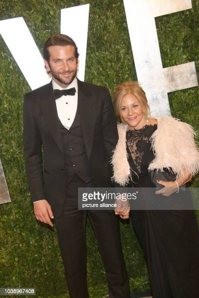 Actor Bradley Cooper and Gloria Cooper arrive at the Vanity Fair Oscar Party at Sunset Tower in West Hollywood Los Angeles USA on 24 February 2013...