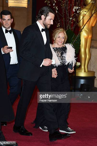 Actor Bradley Cooper and Gloria Cooper depart the Oscars at Hollywood Highland Center on February 24 2013 in Hollywood California