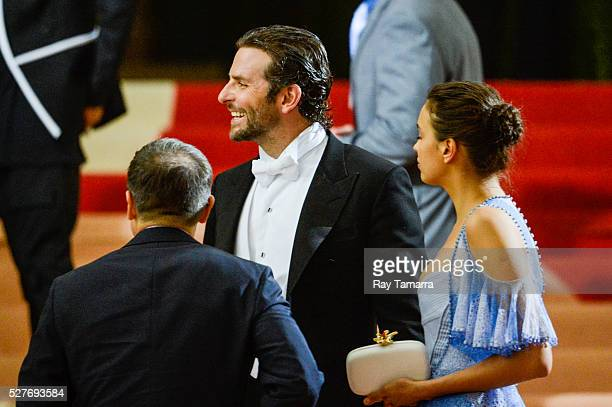 Actor Bradley Cooper and model Irina Shayk leave the 'Manus x Machina Fashion In An Age Of Technology' Costume Institute Gala at the Metropolitan...