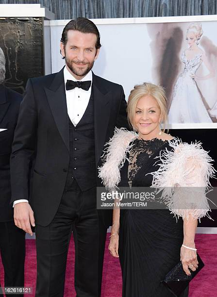Actor Bradley Cooper and mother Gloria Cooper arrive at the Oscars at Hollywood Highland Center on February 24 2013 in Hollywood California