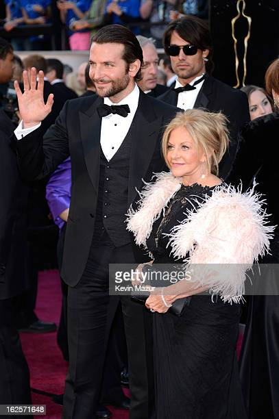 Actor Bradley Cooper and mother Gloria Cooper arrive at the Oscars held at Hollywood Highland Center on February 24 2013 in Hollywood California