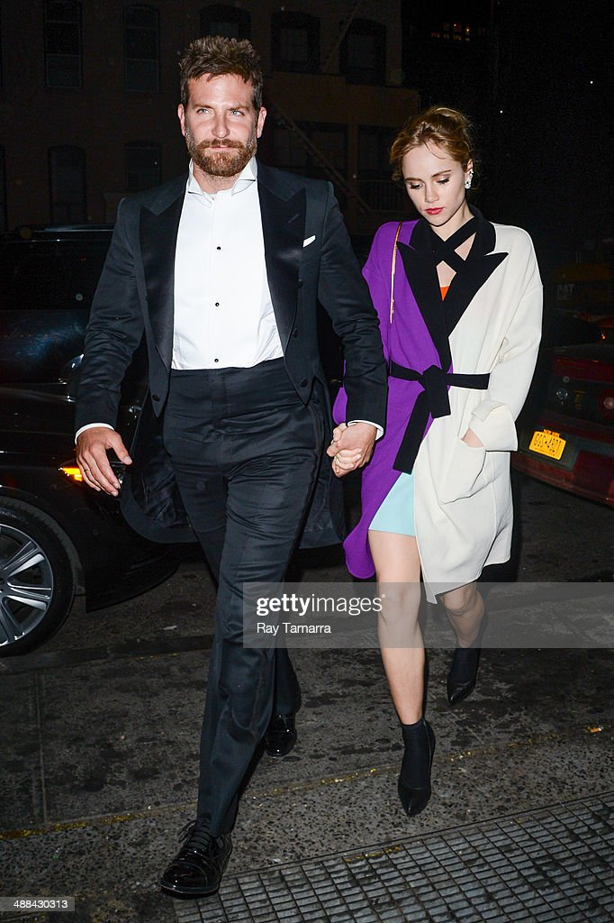 Actor Bradley Cooper (L) and Suki Waterhouse enter the 'Charles James: Beyond Fashion' Costume Institute Gala after party at Up & Down on May 5, 2014 in New York City.