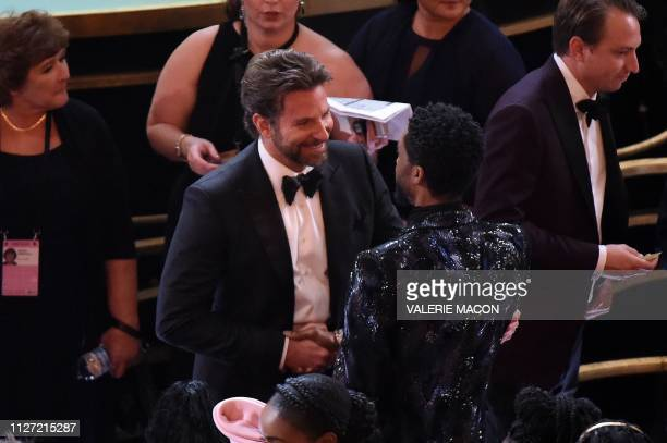 US actor Bradley Cooper and US actor Chadwick Boseman chat during the 91st Annual Academy Awards at the Dolby Theatre in Hollywood California on...