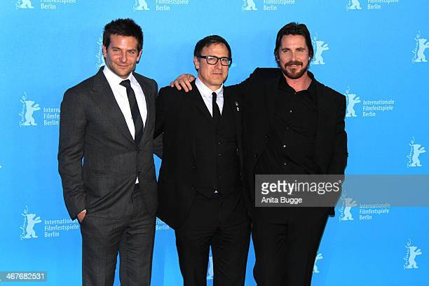 Actor Bradley Cooper director David O Russell and actor Christian Bale attend the 'American Hustle' photocall during 64th Berlinale International...