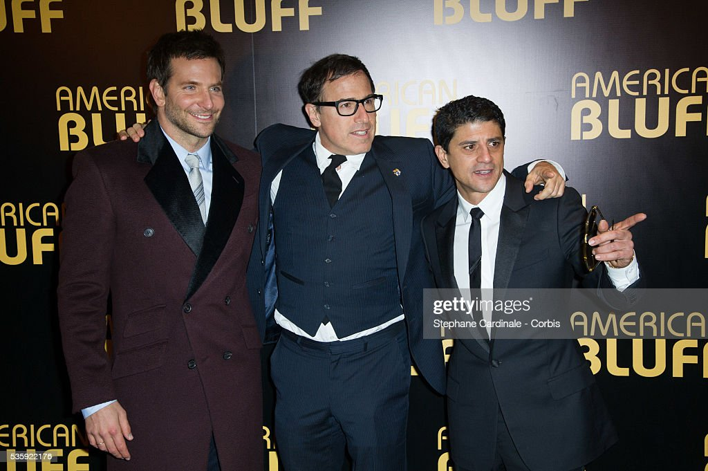 Actor Bradley Cooper, director David O. Russell and actor Said Taghmaoui attend the 'American Bluff' Paris Premiere at Cinema UGC Normandie, in Paris.
