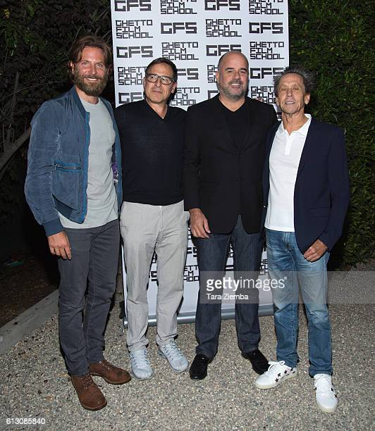 Actor Bradley Cooper director David O Russell founder and president of the Ghetto Film School Joe Hall and producer/host Brian Grazer attend a...
