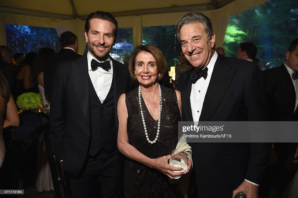 Actor Bradley Cooper, Nancy Pelosi, and Paul Pelosi attend the Bloomberg & Vanity Fair cocktail reception following the 2015 WHCA Dinner at the residence of the French Ambassador on April 25, 2015 in Washington, DC.