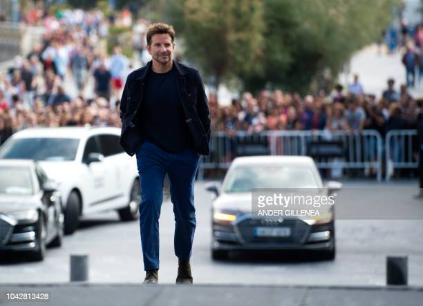 US actor Bradley Cooper poses during a photocall to promote his film A star is born during the 66th San Sebastian Film Festival in the northern...
