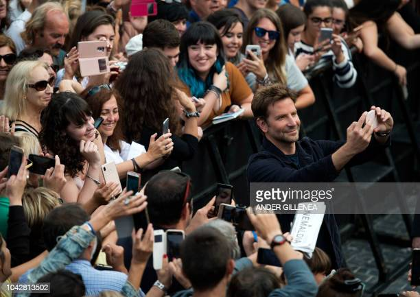 """Actor Bradley Cooper poses during a photocall to promote his film """"A star is born"""" during the 66th San Sebastian Film Festival in the northern..."""