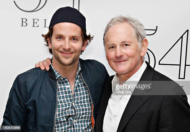 Actor Bradley Cooper poses with actor Victor Garber backstage following his performance at 54 Below on August 20 2012 in New York City