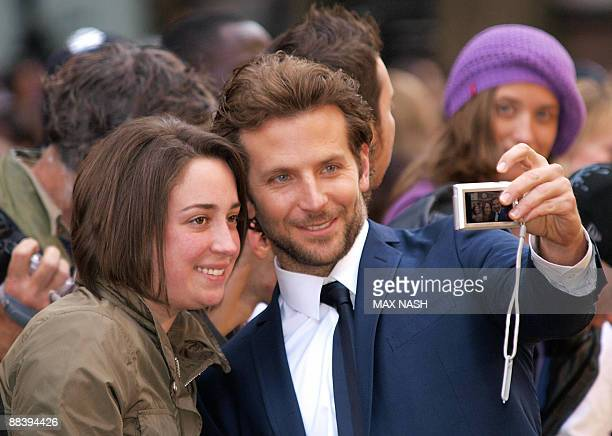 US actor Bradley Cooper poses with his fans as he arrives in London's Leicester Square on June 10 2009 to attend the British premiere of his latest...