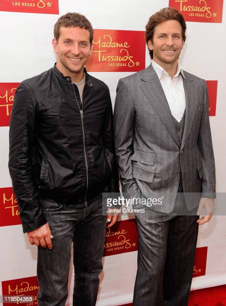 Actor Bradley Cooper poses with his wax figure during the unveiling of his wax figure for Madame Tussauds Las Vegas on July 18 2011 in New York City