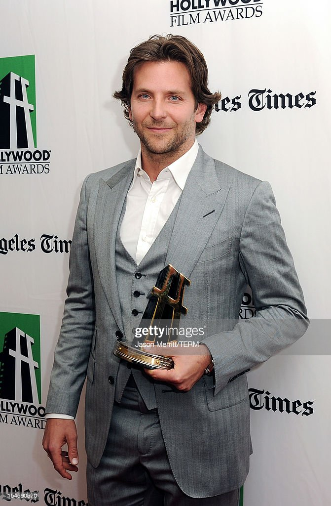 Actor Bradley Cooper poses with the Hollywood Actor Award during the 16th Annual Hollywood Film Awards Gala presented by The Los Angeles Times held at The Beverly Hilton Hotel on October 22, 2012 in Beverly Hills, California.