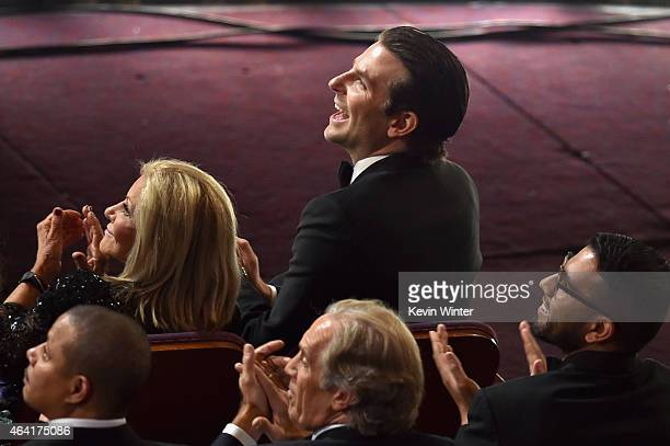 Actor Bradley Cooper reacts from the front row during the 87th Annual Academy Awards at Dolby Theatre on February 22 2015 in Hollywood California