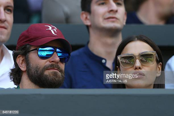 US actor Bradley Cooper sits with Russia model Irina Shayk on centre court before the men's singles quarterfinal match between Switzerland's Roger...
