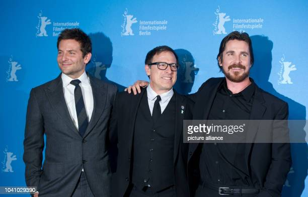 US actor Bradley Cooper US director David O Russell and British actor Christian Bale pose during the photocall for 'American Hustle' at the 64th...