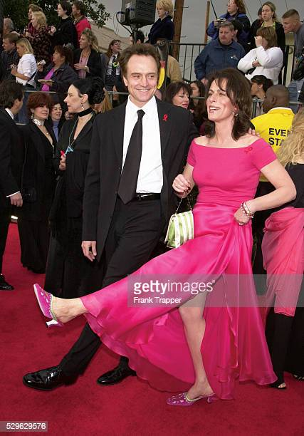 Actor Bradley Whitford and wife actress Jane Kaczmarek arrive at the 2001 Golden Globe Awards held at the Beverly Hilton Hotel This photo appears on...