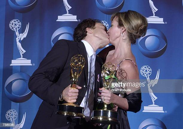 Actor Bradley Whitford kisses actress Allison Janney backstage during the 53rd Annual Primetime Emmy Awards at The Shubert Theater November 4 2001 in...