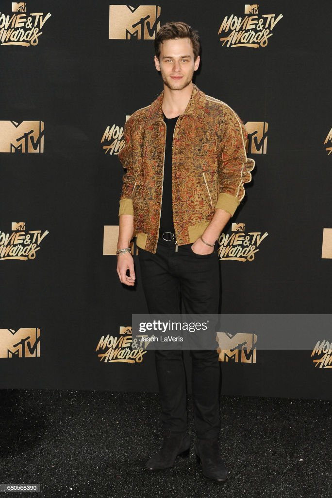 Actor Brandon Flynn poses in the press room at the 2017 MTV Movie and TV Awards at The Shrine Auditorium on May 7, 2017 in Los Angeles, California.